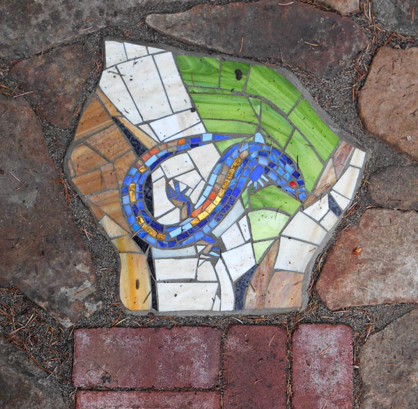 I made this mosaic to pay homage to the little lizards that live in our stone walls.