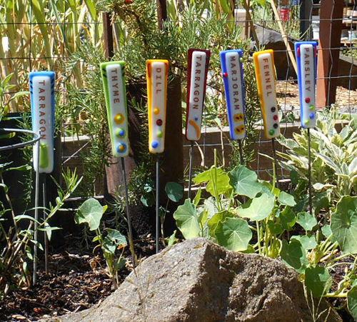 These bright fused glass herb stakes add some fun to a garden.